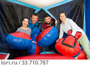 Happy men and women on inflatable arena. Стоковое фото, фотограф Яков Филимонов / Фотобанк Лори