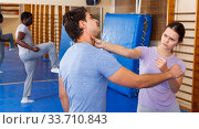 People practicing self defense techniques. Стоковое фото, фотограф Яков Филимонов / Фотобанк Лори