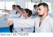 Купить «trainees expressing interest in attending karate class», фото № 33710875, снято 8 апреля 2017 г. (c) Яков Филимонов / Фотобанк Лори