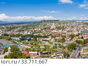 Panoramic view of Tbilisi city from the Narikala Fortress, old town and modern architecture.  Georgia. Стоковое фото, фотограф Николай Коржов / Фотобанк Лори
