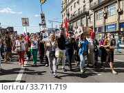 "Купить «Procession of the public movement ""Immortal regiment"" in memory of the 26 million compatriots who died in the Great Patriotic War», фото № 33711719, снято 9 мая 2016 г. (c) Наталья Волкова / Фотобанк Лори"