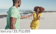 Купить «African American woman invites her husband to following her seaside», видеоролик № 33712055, снято 25 февраля 2020 г. (c) Wavebreak Media / Фотобанк Лори