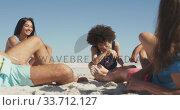 Купить «Friends talking seaside», видеоролик № 33712127, снято 25 февраля 2020 г. (c) Wavebreak Media / Фотобанк Лори