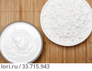 Bowls with cottage cheese and sour cream on the table, top view. Стоковое фото, фотограф Евгений Харитонов / Фотобанк Лори