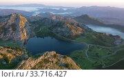 Купить «Mountain lake at sunset in Picos de Europa Natural Park. Spain», видеоролик № 33716427, снято 15 июля 2019 г. (c) Яков Филимонов / Фотобанк Лори