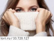 Купить «Blonde young beautiful woman dressed in white woolen sweater .», фото № 33720127, снято 4 декабря 2019 г. (c) Serg Zastavkin / Фотобанк Лори