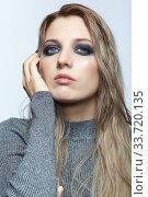 Купить «Blonde young beautiful woman dressed in white woolen sweater.», фото № 33720135, снято 4 декабря 2019 г. (c) Serg Zastavkin / Фотобанк Лори