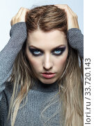 Купить «Blonde young beautiful woman dressed in white woolen sweater.», фото № 33720143, снято 4 декабря 2019 г. (c) Serg Zastavkin / Фотобанк Лори