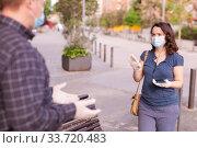 Woman in medical mask asking to keep distance. Стоковое фото, фотограф Яков Филимонов / Фотобанк Лори