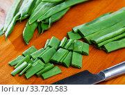 Купить «Sliced green beans on a wooden board», фото № 33720583, снято 26 мая 2020 г. (c) Яков Филимонов / Фотобанк Лори