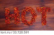 Купить «Word HOT made of dried cayenne pepper», фото № 33720591, снято 25 мая 2020 г. (c) Яков Филимонов / Фотобанк Лори