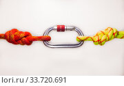 double Flemish loop or figure eight 8 knot with new colored aluminum carabiner. equipment use for attaching rope to climbing harness and create a mustache self insurance. isolated on white background. Стоковое фото, фотограф Алексей Ширманов / Фотобанк Лори