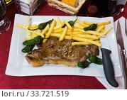 Steak of beef sirloin with fried potatoes. Стоковое фото, фотограф Яков Филимонов / Фотобанк Лори