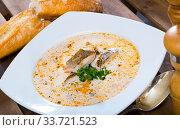 Norwegian codfish soup with baguette. Стоковое фото, фотограф Яков Филимонов / Фотобанк Лори
