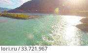 Купить «Low altitude flight over fresh fast mountain river with rocks at sunny summer morning.», видеоролик № 33721967, снято 29 марта 2019 г. (c) Александр Маркин / Фотобанк Лори