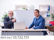 Купить «Yound and old employees in business presentation concept», фото № 33722731, снято 21 октября 2019 г. (c) Elnur / Фотобанк Лори