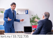 Купить «Yound and old employees in business presentation concept», фото № 33722735, снято 21 октября 2019 г. (c) Elnur / Фотобанк Лори