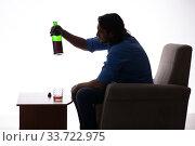 Купить «Young man suffering from alcoholism», фото № 33722975, снято 10 сентября 2019 г. (c) Elnur / Фотобанк Лори