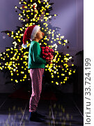 Christmas spirit boy hold tree decoration toys. Стоковое фото, фотограф Сергей Новиков / Фотобанк Лори