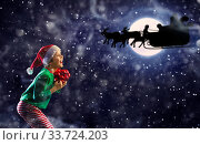 Купить «Exited boy and Santa Claus sledge over the moon», фото № 33724203, снято 30 января 2019 г. (c) Сергей Новиков / Фотобанк Лори