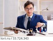 Купить «Young lawyer playing chess to train his court strategy and tacti», фото № 33724343, снято 31 июля 2018 г. (c) Elnur / Фотобанк Лори