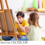 Купить «Young couple enjoying painting at home», фото № 33725135, снято 11 июля 2018 г. (c) Elnur / Фотобанк Лори