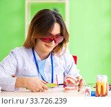 Купить «Woman dentist working on teeth implant», фото № 33726239, снято 11 июня 2018 г. (c) Elnur / Фотобанк Лори