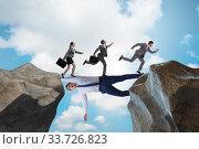 Купить «Businessman acting as a bridge in support concept», фото № 33726823, снято 20 мая 2020 г. (c) Elnur / Фотобанк Лори