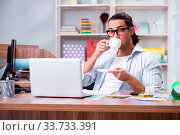 Купить «The young male designer working in the office», фото № 33733391, снято 6 июля 2020 г. (c) easy Fotostock / Фотобанк Лори