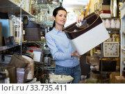 Nice woman choosing purpose basket. Стоковое фото, фотограф Яков Филимонов / Фотобанк Лори