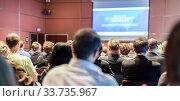 Speaker giving presentation on scientific business conference. Стоковое фото, фотограф Matej Kastelic / Фотобанк Лори