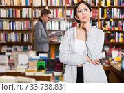 Купить «pensive girl in interior of bookstore», фото № 33738831, снято 18 января 2018 г. (c) Яков Филимонов / Фотобанк Лори