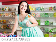 Sexy happy girl with lollipop at sweets shop. Стоковое фото, фотограф Яков Филимонов / Фотобанк Лори