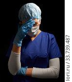 Купить «sad doctor or nurse in goggles and face mask», фото № 33739487, снято 2 апреля 2020 г. (c) Syda Productions / Фотобанк Лори