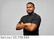 Купить «african american man with crossed arms», фото № 33739543, снято 15 декабря 2019 г. (c) Syda Productions / Фотобанк Лори