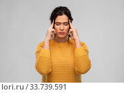 Купить «stressed young woman holding to her head», фото № 33739591, снято 20 марта 2020 г. (c) Syda Productions / Фотобанк Лори