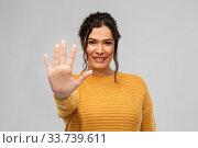 Купить «happy woman in pullover showing five fingers», фото № 33739611, снято 20 марта 2020 г. (c) Syda Productions / Фотобанк Лори