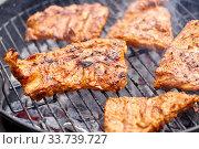 Купить «close up of barbecue meat roasting on grill», фото № 33739727, снято 19 сентября 2019 г. (c) Syda Productions / Фотобанк Лори