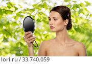 Купить «beautiful young woman looking to mirror», фото № 33740059, снято 30 ноября 2019 г. (c) Syda Productions / Фотобанк Лори