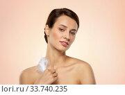 Купить «beautiful woman with feather touching her face», фото № 33740235, снято 30 ноября 2019 г. (c) Syda Productions / Фотобанк Лори