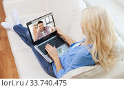 woman with laptop having video call with man. Стоковое фото, фотограф Syda Productions / Фотобанк Лори