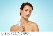 Купить «beautiful woman with feather touching her face», фото № 33740663, снято 30 ноября 2019 г. (c) Syda Productions / Фотобанк Лори