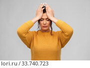 Купить «stressed young woman holding to her head», фото № 33740723, снято 20 марта 2020 г. (c) Syda Productions / Фотобанк Лори