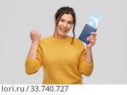 Купить «happy young woman with air ticket and passport», фото № 33740727, снято 20 марта 2020 г. (c) Syda Productions / Фотобанк Лори