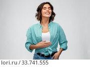 Купить «happy full young woman touching her tummy», фото № 33741555, снято 18 апреля 2020 г. (c) Syda Productions / Фотобанк Лори