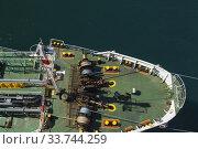 Купить «Top view of winches and ropes on bow of fuel oil bunker vessel, Piraeus port, Athens, Greece.», фото № 33744259, снято 29 сентября 2019 г. (c) age Fotostock / Фотобанк Лори