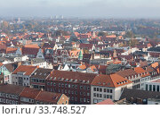 Lubeck, Germany. Aerial view of Lubeck. Red tiled roofs of old houses in the Old Town. (2018 год). Стоковое фото, фотограф Наталья Николаева / Фотобанк Лори