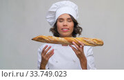 happy female chef with french bread or baguette. Стоковое видео, видеограф Syda Productions / Фотобанк Лори