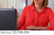 Купить «woman with laptop having video call at home office», видеоролик № 33749059, снято 11 апреля 2020 г. (c) Syda Productions / Фотобанк Лори