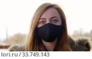 woman wearing protective reusable barrier mask. Стоковое видео, видеограф Syda Productions / Фотобанк Лори